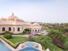 At the Oberoi Udaivilas Hotel in #India, check-in starts with a private boat ride past palaces on Lake Pichola, and a personal butler escorts guests to one of the 87 rooms and suites. How luxurious! #WorldsBestHotels