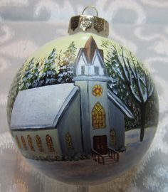 A winter scene of a church with pine trees is carefully hand painted on a 4 glass bulb. The back is plain and can be personalized at no charge. Makes a great gift for someone hard to buy for.