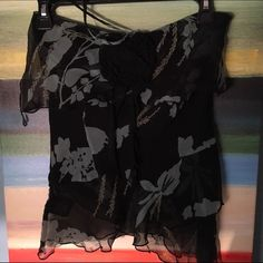 Ruffle Halter w/ Flower - Bebe Brand new Bebe Halter. Has strands to tie around your neck as well as a zipper to the side. bebe Tops Blouses