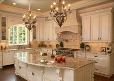 Love the counter tops and the color of the cabinets with the candelabra light.