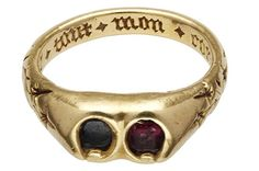 """A posy ring with a little bit of bling; this circa 14th century gold ring is set with a sapphire and a garnet and has flowers engraved on the outer ring. Inside, the inscription is written in French in Gothic script and translates to """"with all my heart."""""""