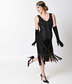For those who want want a bit of adventure with their music, youll love the artistic appeal of the black Hawkins flapper from Unique Vintage! This art deco drenched flapper dress boasts a knee-length semi-fitted style silhouette in a softly lined chiffon