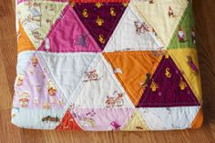 a quilt is nice: triangles Cute use of Heather Ross prints --would be cute with some white sashing too.