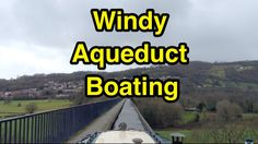 Don't look down everybody! Time to take a very windy narrowboat trip over Pontcysyllte Aqueduct! Hold on tight!