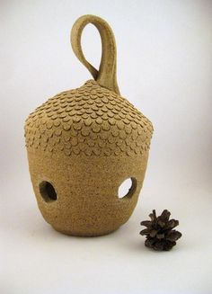 oh I love this! My acorn fetish, realized, and in lantern form. Indoor/outdoor. PoFu's etsy shop.