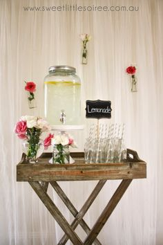 drinks display for wedding butler table beverage dispenser hanging mini bottles back drop. buy products from www.sweetlittlesoiree.com.au