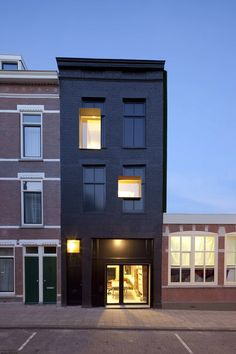 Great concept to leave the old windows in the facade and integrate new ones as a obvious second generation design. Old school meets new school! - Black Pearl House: a 100 year old, neglected Rotterdam house renovated by Studio. Black Architecture, Minimalist Architecture, Contemporary Architecture, Interior Architecture, Rotterdam Architecture, Creative Architecture, Architecture Wallpaper, Design Exterior, Black Exterior