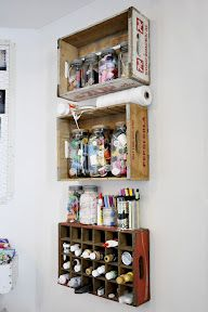 Vintage crates as wall storage.