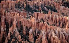 Bryce Canyon   Despite the name, Bryce Canyon – in southwestern Utah – is not a canyon. It's actually a series of bizarrely shaped, giant stone amphitheatres made up of red, orange and yellow hoodoos (thin spears of rock, also known as fairy chimneys or earth pyramids). Today visitors hike and drive to look out points around the park to watch the sun rise and set over this extraordinary, fiery landscape.