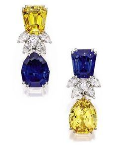 Pair of Tiffany & Co. platinum, sapphire, and diamond earclips. A yellow sapphire tops one clip, a blue sapphire pendant dangles beneath. On the other ear, the colors are reversed. Sapphire Pendant, Sapphire Jewelry, Sapphire Earrings, Diamond Jewelry, Blue Sapphire, Diamond Stud, Stud Earrings, Platinum Earrings, Rough Diamond