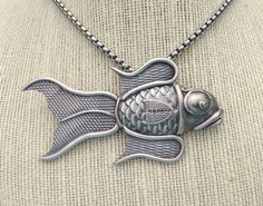 by Sheri Mallery,   Sterling Silver metal clay fish as learned in Michael Marx class.
