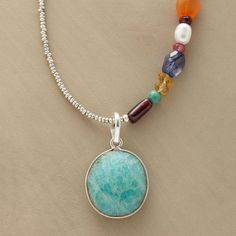 """OFF CENTER NECKLACE--One faceted amazonite pendant hangs between sterling silver seed beads and multicolored gems of apatite, carnelian, garnet, mystic pink quartz, citrine, turquoise, iolite and cultured rice pearl. Amazonite heishi beads complete the strand. Toggle clasp. Handcrafted in USA exclusively for us. 18""""L."""