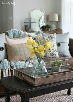Brown and blue living room with pop of yellow