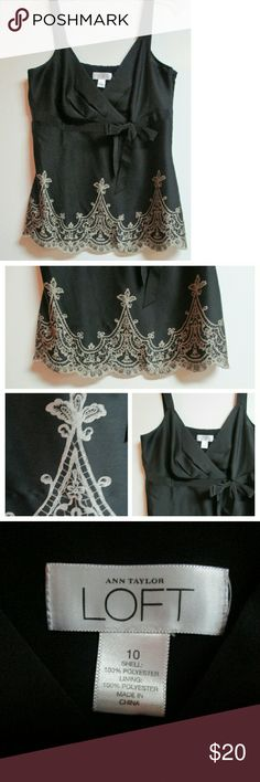 "Loft  Black Silk & Lace Camisole Top Ann Taylor Loft Black silky camisole style top with faux lace embroidery around bottom. It is actually printed on the material. Also has black grosgrain  ribbon accent that ties under bust line. Fully lined, sleeveless, & has hidden side zipper under arm.  Shell & Lining both 100% polyester. Excellent condition Approx 25"" long, approx 17"" armpit to armpit. Strap are NOT adjustable.  All proceeds go to Charity. was $25 LOFT Tops Camisoles"