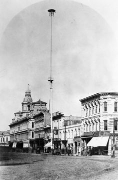 In the early 1880s (this photo is circa 1882) the city of Los Angeles installed seven electric street lights. This one is at the corner of Main and Commercial Streets in downtown LA. For some reason, they were 150 feet tall. From that height, I can't imagine they shed might light for sidewalk pedestrians, especially using 1880s technology, and it's not like they served as beacon for aircraft or drones. Can anyone solve this mystery for us?