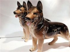 ITEM #RA-44  This is a pair of 1940s art deco porcelain German Shepherd dog figurines, both marked JAPAN in brown.  Condition: Both are Very good antique condition with typical wear due to age and handling. No chips cracks etc. One has a teeny tiny paint skip underneath the glaze as shown in second photo, and is a manufactures flaw. Any other spots are from the camera and the glaze. Very light crazing seen upon close inspection.  **I have purchased a huge estate full of glassware, and will…
