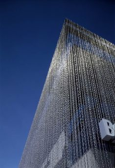 the BankA cascade of 11km chains on the facade changes, shimmers and modifies its physical consistency