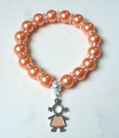 pulsera en perla dije en acero niña diseño de color beads.