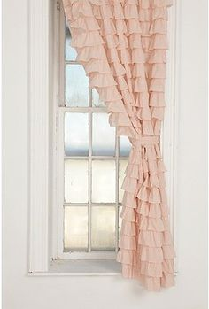 Waterfall Ruffle Curtain from UO. Thinking of painting the walls pink but can't commit.  Maybe this lovely curtain will add the right amount of girly and pink to a white room.