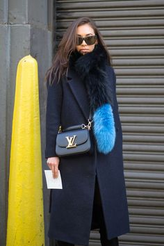 One of the newest ways to layer this season is with a fur stole. Choose one in a punchy hue for added interest.