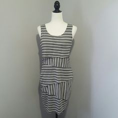 Black, gray, and white striped  sleeveless dress Excellent condition. 48% rayon 48% polyester 4% polyurethane . lining 6% polyurethane 94% rayon. Fast shipping! Reasonable offers accepted. Thank you for shopping my closet! Dresses Midi