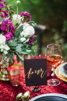 calligraphy table number - photo by Awake Photography http://ruffledblog.com/moody-woodland-romance-wedding-editorial