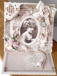 handmade card from Lenas papperspyssel ... easel card ... shabby chic ... photo ... artificial flowers, lace and die cuts ... definitely meant for display ...