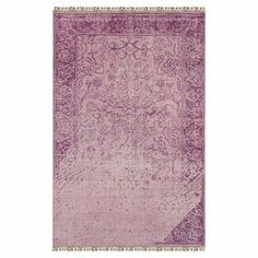 Add a pop of style to your dining room or den with this hand-knotted wool rug, showcasing an eye-catching damask motif and chic fringed edges.  Product: RugConstruction Material: Wool and art silkColor: PurpleFeatures: Hand-knottedNote: Please be aware that actual colors may vary from those shown on your screen. Accent rugs may also not show the entire pattern that the corresponding area rugs have.