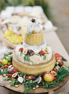 stacked cheese-block cake, fruit + nut platter / Photography: Cooper Carras,Event Coordination: Kelly & Company Events,Floral Design: Grant Avenue Florist
