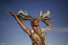 An Israeli woman dances during the 2015 Midburn festival in the Negev Desert near the Israeli kibbutz of Sde Boker on May Some 6000 Israelis and foreigners attended the five days of the Midburn festival, the Israeli version of the popular Burnin Images Of Braids, Black Rock Desert, Burning Man Fashion, Burns, Wonder Woman, Style Inspiration, Western Wall, Saturday Morning, Jerusalem