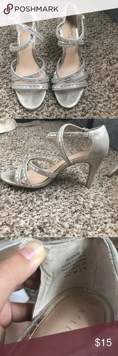 Silver high heels These shoes have only been worn once for prom Kelly & Katie Shoes Heels