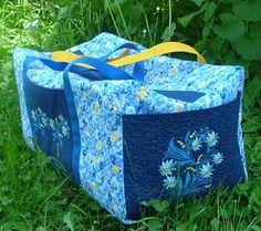 Advanced Embroidery Designs. Free Projects and Ideas. Quilted Duffle Bag with Embroidered Pockets.