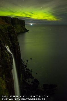 Aurora beyond Kilt Rock, Isle of Skye, Scotland.