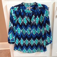 Banana Republic Blouse Super Fun, BANANA REPUBLIC Blouse, 3/4 length sleeves, gorgeous turquoise, royal blue, and navy print.. Looks super cute with white jeans, it has a v neck with 2 buttons, size Small worn only 2 times, excellent condition Banana Republic Tops Blouses