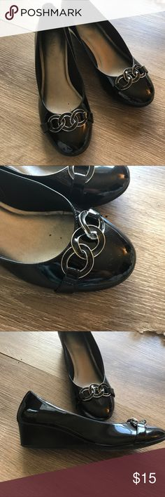Shiny black wedges with buckles Low heel wedges, 1.5 inches, perfect for work! Cute buckle design at toes. Only worn handful of times. Size 8. Kelly & Katie Shoes Wedges