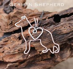 My own original designs, these lovely dogs are carefully crafted out of copper wire and sterling silver wire (heart). They are oxidized and