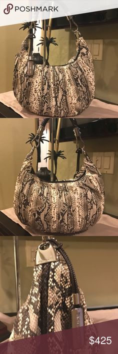 Skorpios!  Michael Kors Hobo Absolutely stunning MK Snakeskin Skorpios Hobo. Braided dark brown handles and trim set in gorgeous silver hardware. Retails at $895. This is a must have for your collection! Michael Kors Bags Hobos