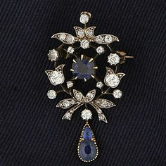A late Victorian sapphire and diamond brooch/pendant