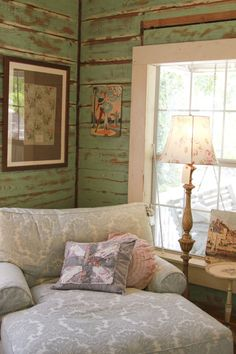 rustic wall treatment - Love the big comfy chair in the middle of all that rustic charm...