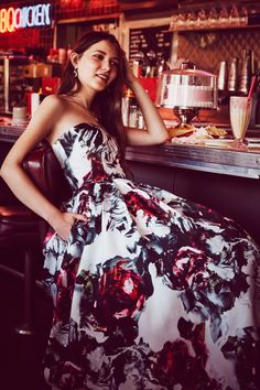 A floral strapless ball gown for prom? Yes, please. Shop this prom dress at David's Bridal