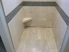 Elegant Marble Shower With Linear Drain And Shaving Foot Rest For The Ladies. Tile  Installed By