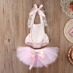 This Birthday Sparkle Couture set is my absolute favorite. Every thing about it represents what little girls are made of, classic, timeless,vintage soft pink with lace and gold trim.  With this listing you will receive one of our gorgeous rompers and tutu skirts. Add one of our custom halos or head