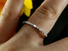 Ladies halfway wedding band with natural round and baguette cut diamonds in 14k white gold.  Style # - KBR-3314 Material - 14K , 18K White