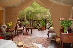 I went on a two week Safari in Kenya. We stayed at this place for four days. Fabulous tent. 4-poster twin beds, marble bathroom, and oriental rugs. I was traveling alone so the tour company put me in with a room-mate.