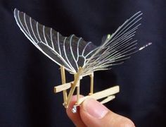 An ornithopter is a rubber band powered plane that flaps its wings. Leonardo da Vinci drew pictures of ornithopters in his famous sketchbook. Kinetic Toys, Kinetic Art, Design Industrial, Diy And Crafts, Paper Crafts, Model Airplanes, Paper Models, Rubber Bands, Wood Toys