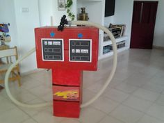 Cardboard gas station i made for speedy mcqueen birthday party #diy #boys #toy