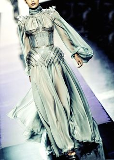 Love me a bit of military armor /uniform Joan of Arc inspiration! Sea blue green swirling silk dress with delicious structured outer corsetry!