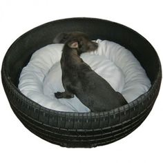 Repurposed tire into pet dog bed, add pillow; from ibtikarwold. Upcycle, Recycle, Salvage, diy, thrift, flea, repurpose, refashion! For vintage ideas and goods shop at Estate ReSale & ReDesign, Bonita Springs, FL