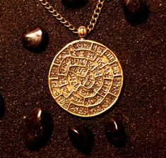 Phaistos Disk : Bronze Handmade Pendant with chain by MagicBronze on Etsy