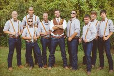 Casual blue jeans, suspenders, and bow ties for groom and groomsmen // J Photography